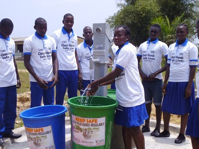 YMCA constrcuted hand pump and sanitation buckets in use